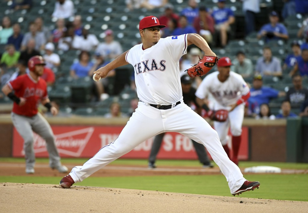 Texas Rangers starting pitcher Ariel Jurado works against the Los Angeles Angels during the first inning of a baseball game, Thursday, Aug. 16, 2018, ...