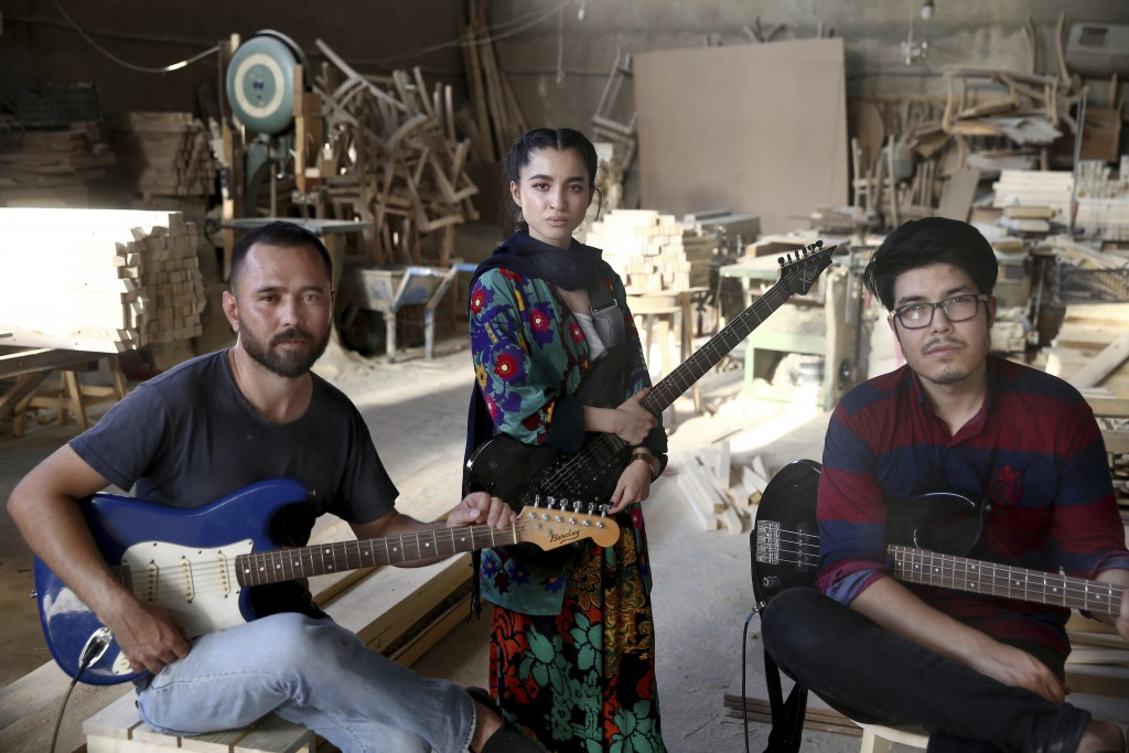 In this Thursday, July 26, 2018, photo, Afghan musicians Mohammad Rezai, right, Hakim Ebrahimi, left, and Soraya Hosseini, members of the Arikayn rock...
