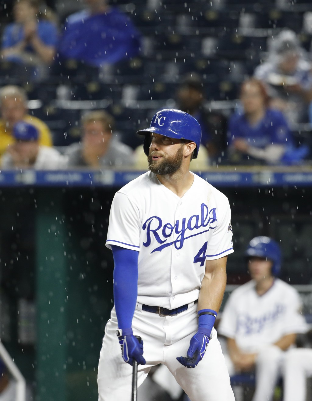 Kansas City Royals' Alex Gordon reacts as rain resumes in the first inning, after a two-hour rain delay before the start of the team's baseball game a...
