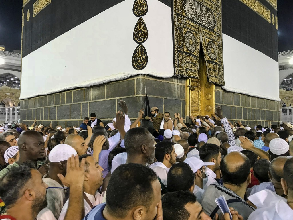 Muslim pilgrims circle the Kaaba, the cubic building at the Grand Mosque, ahead of the annual Hajj pilgrimage, in the Muslim holy city of Mecca, Saudi...