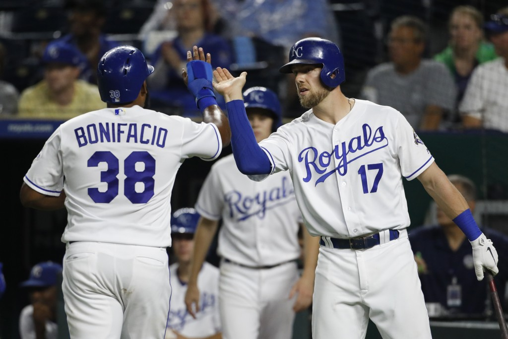 Kansas City Royals' Jorge Bonifacio (38) is congratulated by Hunter Dozier (17) after scoring on a Ryan O'Hearn single during the fourth inning of a b...