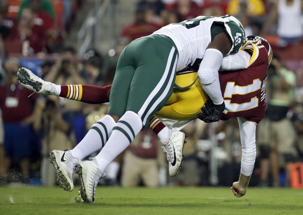 New York Jets linebacker Jordan Jenkins (48) hits Washington Redskins quarterback Alex Smith (11) during the first half of a preseason NFL football ga...
