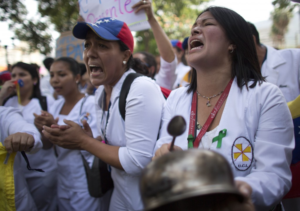 Nurses shout anti-government slogans during a protests demanding higher, fair wages and against the government of President Nicolas Maduro, in Caracas...