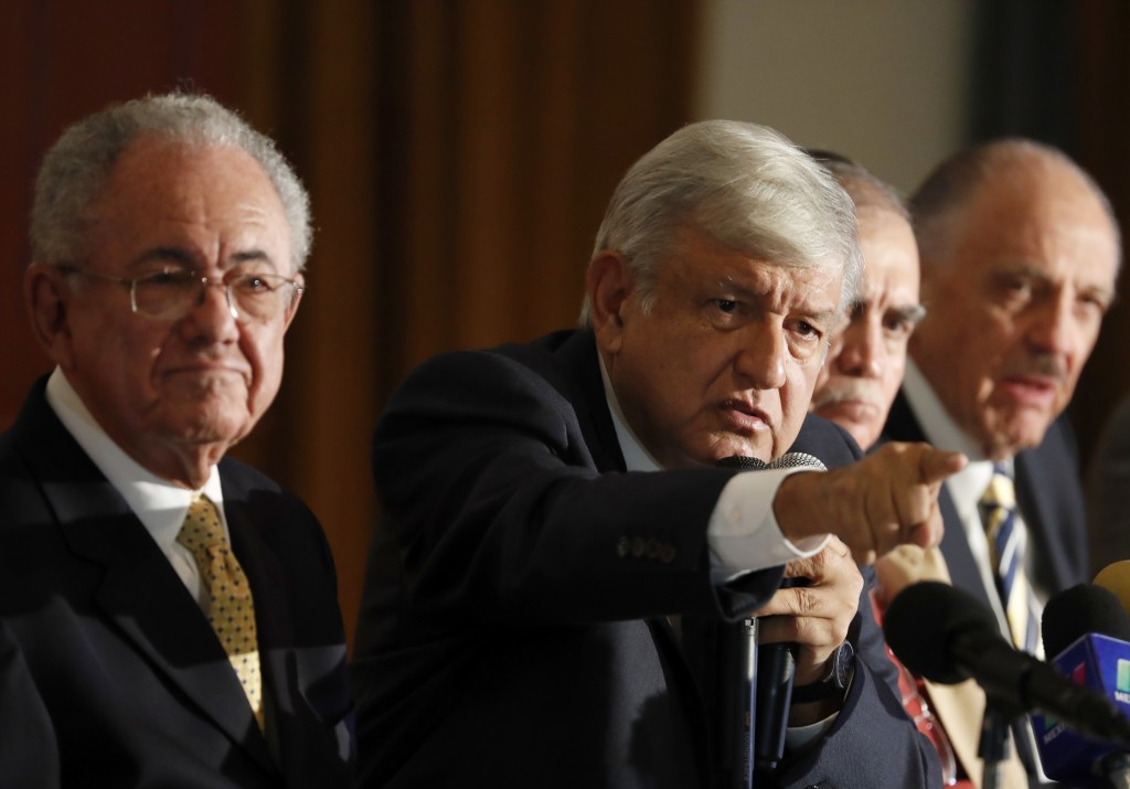 Mexico's President Elect Andres Manuel Lopez Obrador, second left, speaks during a press conference about the the future of Mexico City's planned new ...