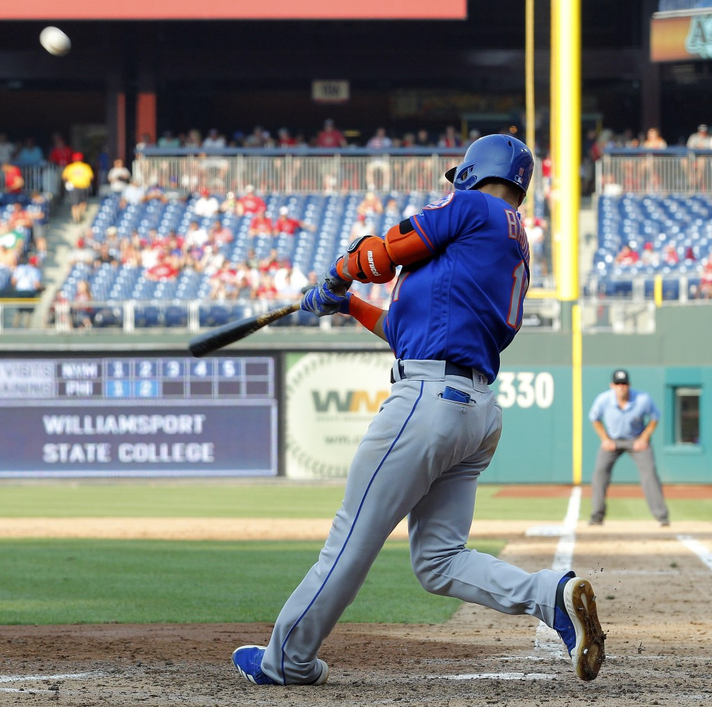 New York Mets' Jose Bautista connects for a grand slam during the fifth inning against the Philadelphia Phillies in a baseball game Thursday, Aug. 16,...