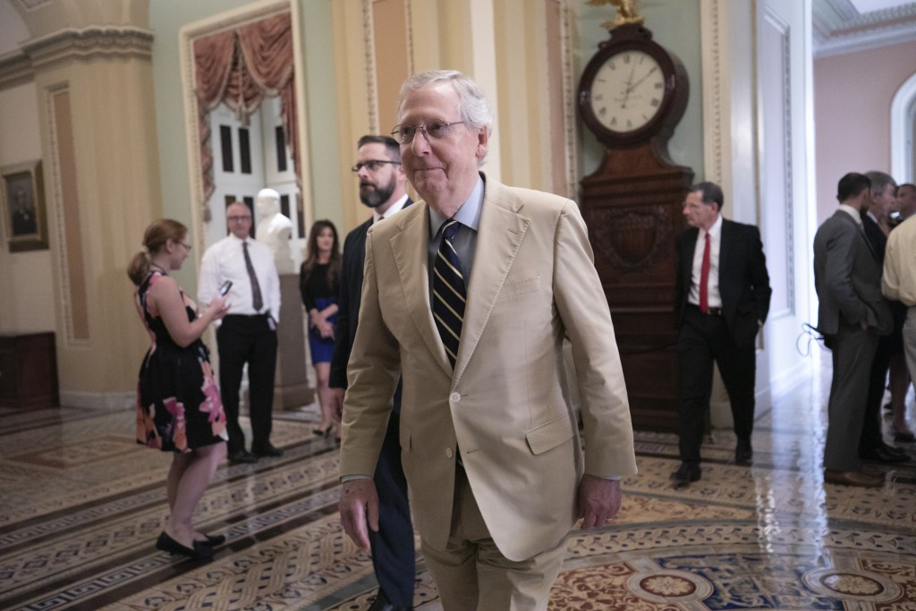 IN this Aug. 16, 2018, photo, Senate Majority Leader Mitch McConnell, R-Ky., arrives at the chamber to begin work on a judicial confirmation, at the C...
