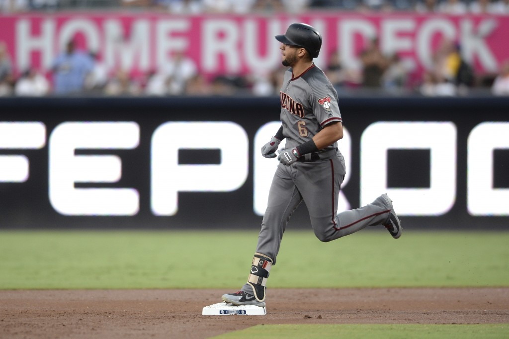 Arizona Diamondbacks' David Peralta rounds the bases after hitting a three-run home run during the first inning of a baseball game against the San Die...