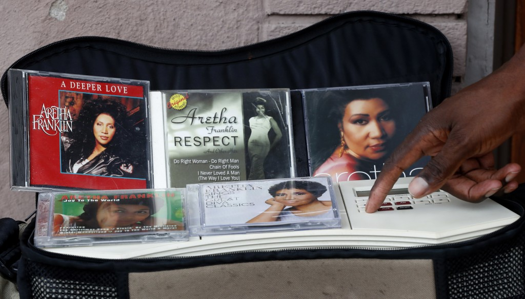 Various Aretha Franklin compact discs are shown while being played outside New Bethel Baptist Church in Detroit, Thursday, Aug. 16, 2018. Aretha Frank...