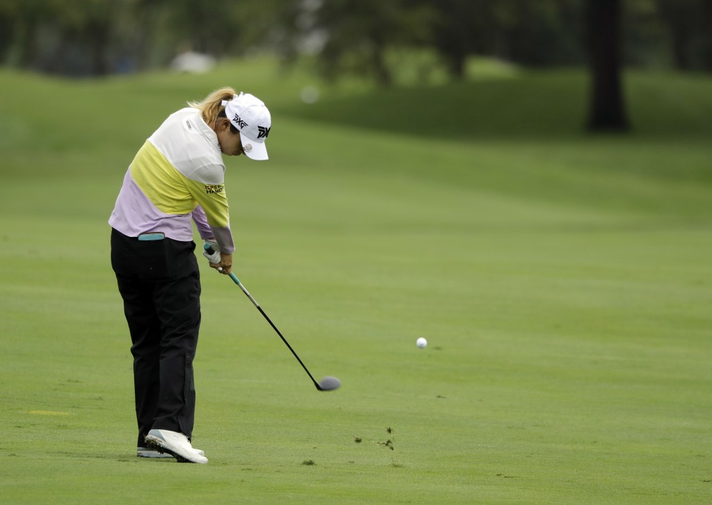 Lydia Ko, of New Zealand, hits from the 14th fairway during the first round of the Indy Women in Tech Championship golf tournament, Thursday, Aug. 16,...