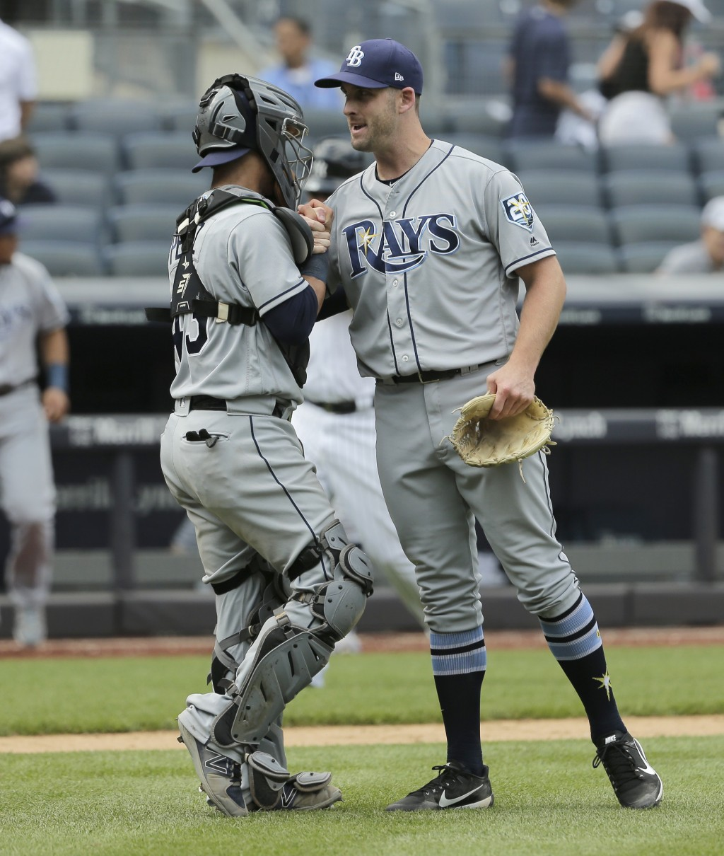 Tampa Bay Rays relief pitcher Adam Kolarek, right, and catcher Michael Perez celebrate after the ninth inning of a baseball game against the New York ...