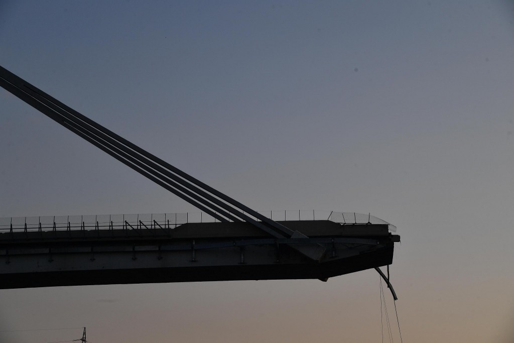 A view of the partially collapsed Morandi highway bridge in Genoa, Italy, Thursday, Aug. 16, 2018. Italian authorities have lowered the death to 38 fr...