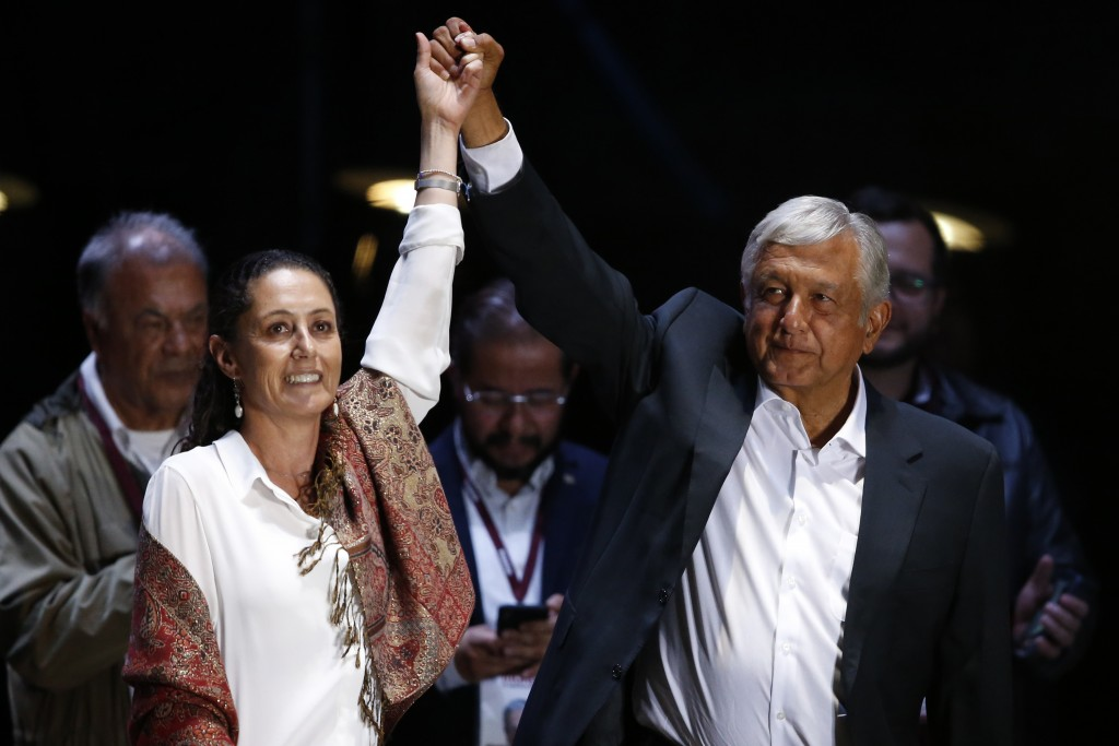 FILE - In this June 27, 2018 file photo, presidential candidate Andres Manuel Lopez Obrador, right, and Mexico City mayoral candidate Claudia Sheinbau...