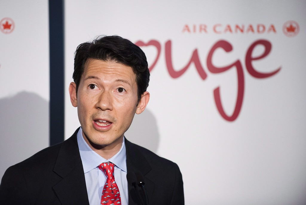 In this Dec. 18, 2012, photo, executive vice-president Benjamin Smith unveils the new leisure airline Air Canada Rouge in Toronto. Air Canada's chief ...
