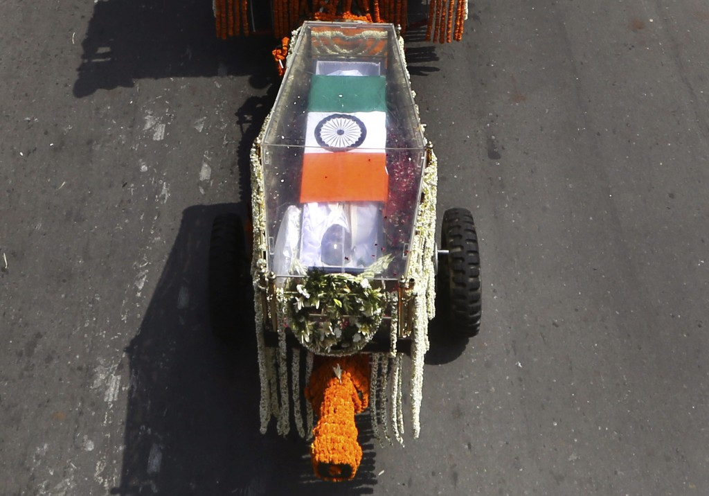 The body of former Indian Prime Minister Atal Bihari Vajpayee, wrapped in the Indian national flag, is taken in full state honor to the Bharatiya Jana...