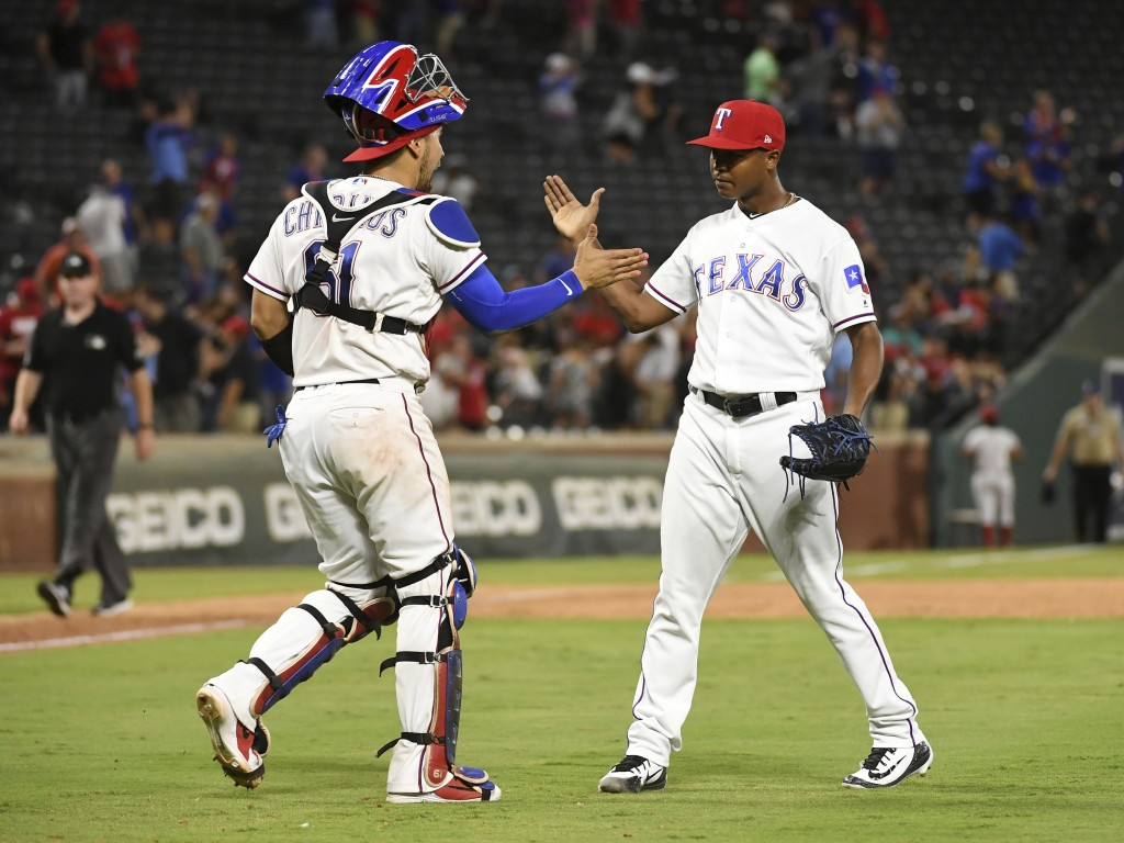 Texas Rangers catcher Robinson Chirinos and relief pitcher Jose Leclerc celebrate after Leclerc struck out Los Angeles Angels' Eric Young Jr. for the ...