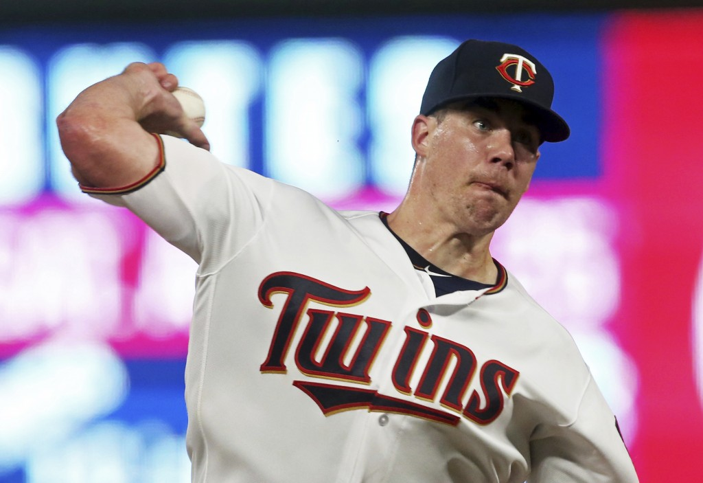 Minnesota Twins pitcher Trevor May throws to a Detroit Tigers batter during the fifth inning of a baseball game Thursday, Aug. 16, 2018, in Minneapoli...