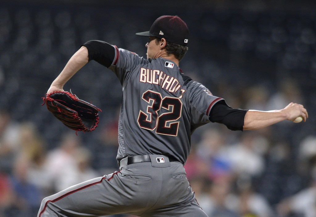 Arizona Diamondbacks starting pitcher Clay Buchholz works against a San Diego Padres batter during the ninth inning of a baseball game Thursday, Aug. ...