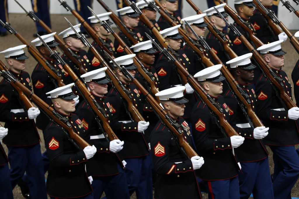 FILE - In this Jan. 20, 2017 file photo, Marines march during the 58th Presidential Inauguration parade for President Donald Trump in Washington. Trum...