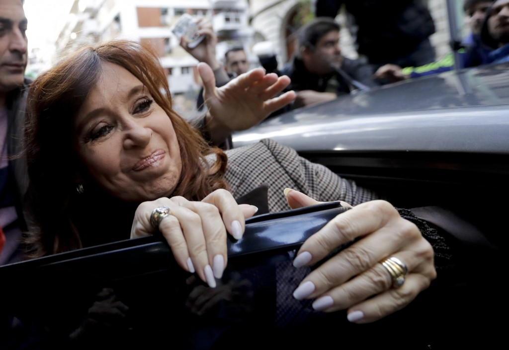 In this Aug. 13, 2018 photo, Argentina's former President Cristina Fernandez gets into a car to go to a court hearing in Buenos Aires, Argentina. Fern...