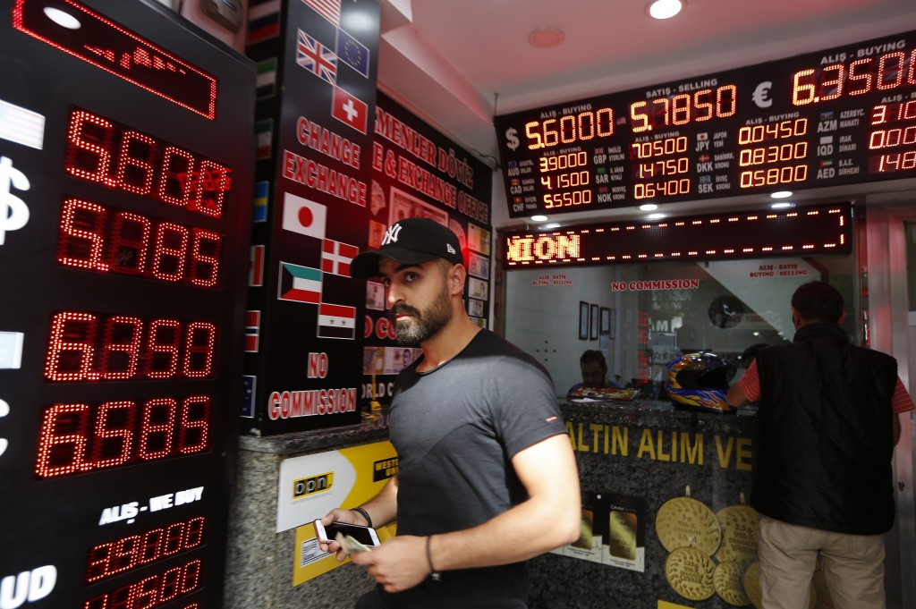 A man walks out of a currency exchange shop in Istanbul, Thursday, Aug. 16, 2018. Beset by a weak currency and tension with the United States, Turkey ...