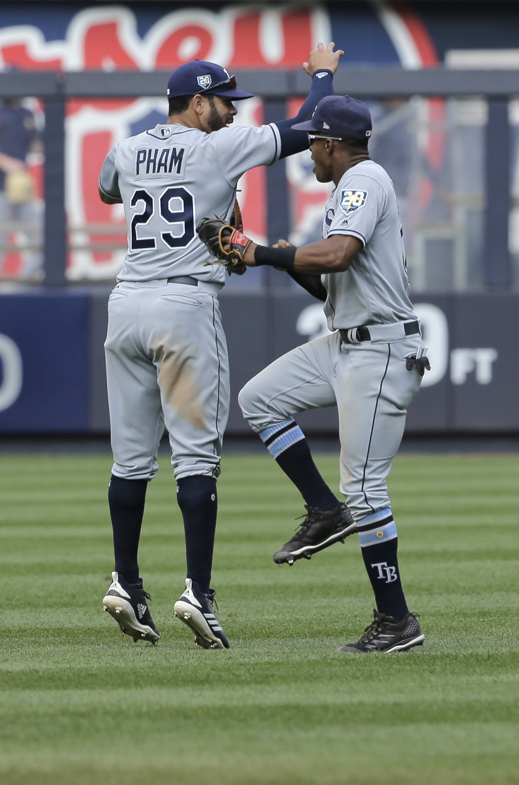 Tampa Bay Rays' Tommy Pham, left, and Mallex Smith celebrate after the ninth inning of a baseball game against the New York Yankees at Yankee Stadium ...
