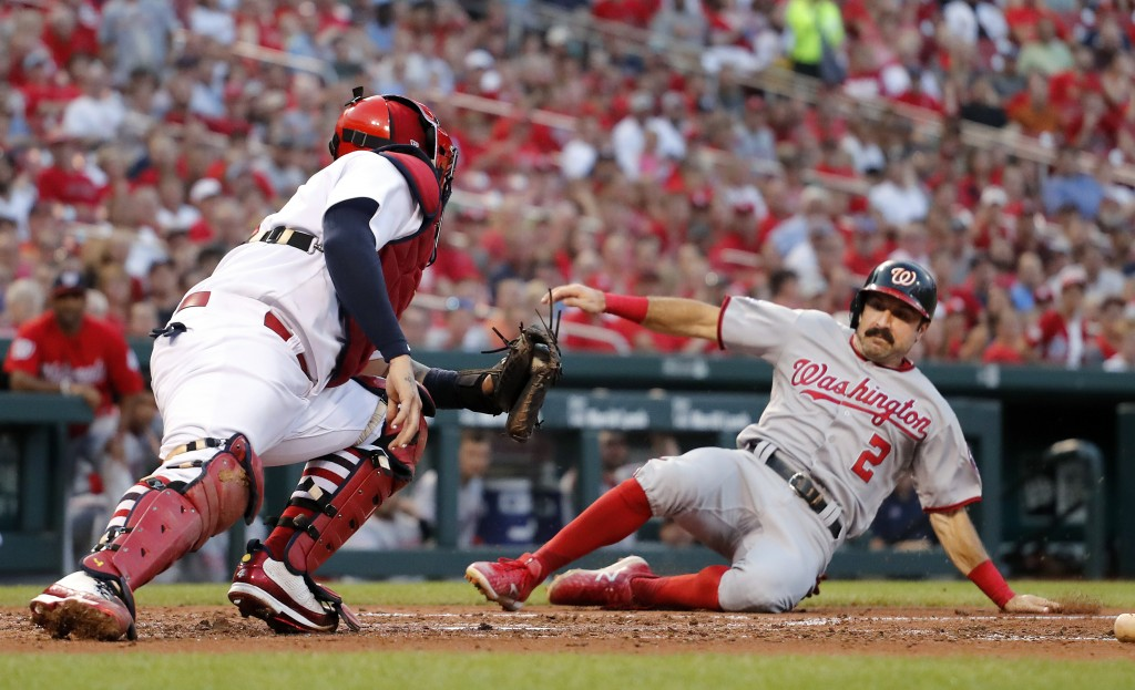 Washington Nationals' Adam Eaton (2) scores past St. Louis Cardinals catcher Yadier Molina during the fourth inning of a baseball game Thursday, Aug. ...