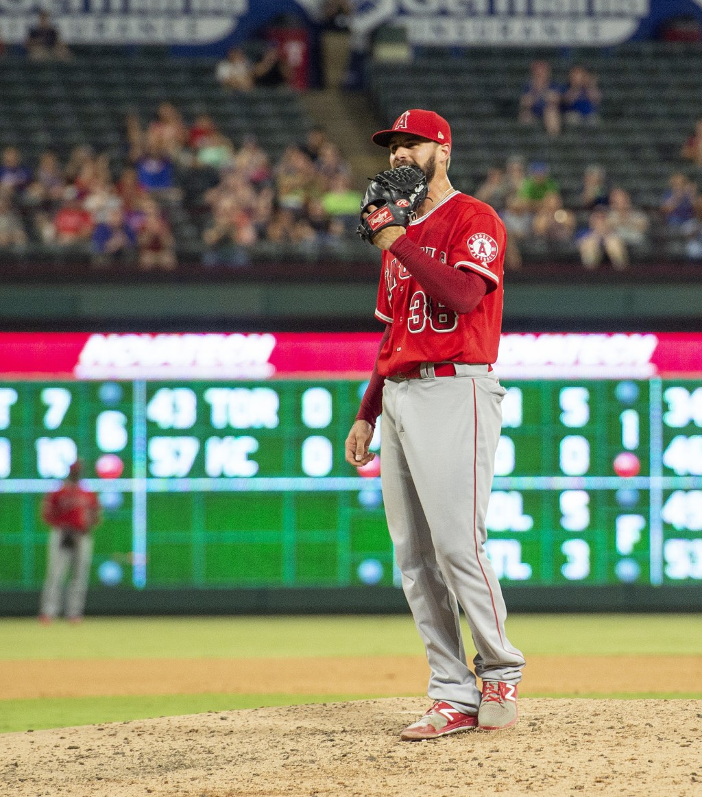 Los Angeles Angels relief pitcher Justin Anderson reacts after issuing a bases-loaded walk to Texas Rangers' Shin-Soo Choo which scored Jurickson Prof...