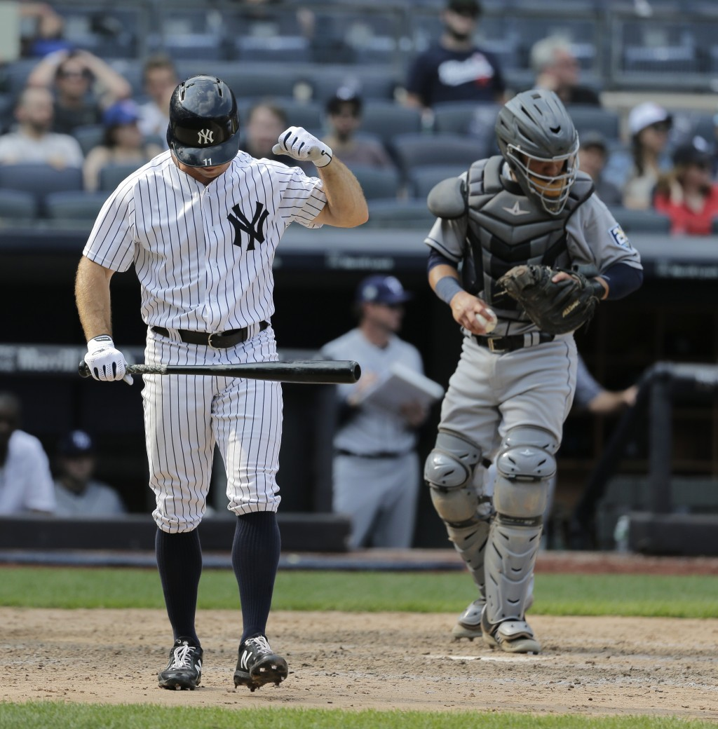 New York Yankees' Brett Gardner reacts after striking out with the bases loaded during the ninth inning of a baseball game against the Tampa Bay Rays ...