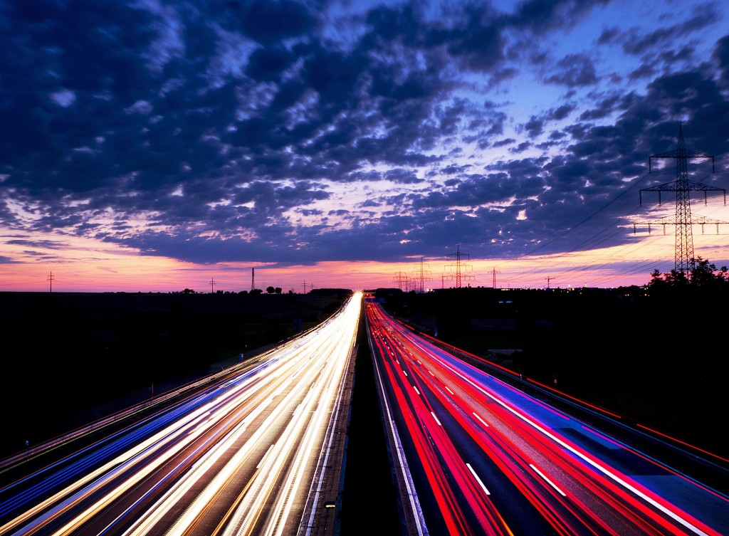 Long exposure picture shows driving cars on the highway just before sunrise near Frankfurt , central Germany, Friday, Aug. 17, 2018. (AP Photo/Michael...