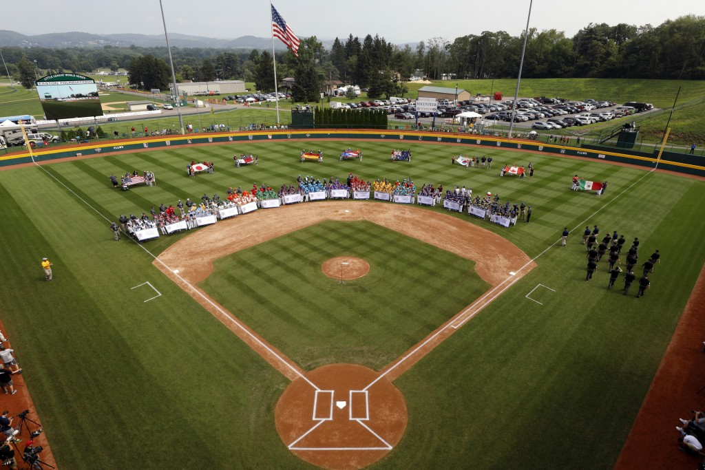 The 16 Little League teams competing in the 2018 Little League World Series baseball tournament line the field at Volunteer Stadium during the opening...