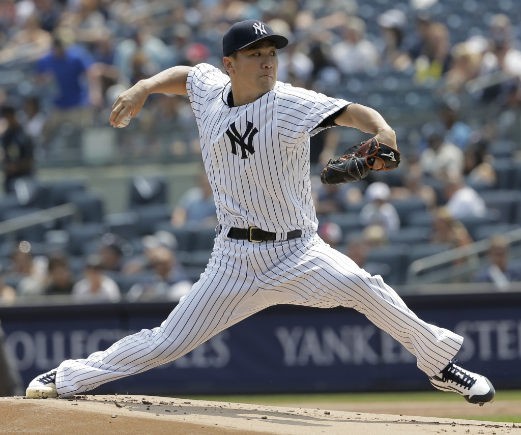 New York Yankees starting pitcher Masahiro Tanaka throws during the first inning of a baseball game against the Tampa Bay Rays at Yankee Stadium Thurs...