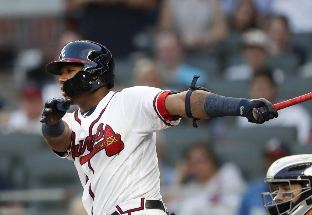 Atlanta Braves' Ronald Acuna Jr. follows through on a single in the first inning of a baseball game against the Colorado Rockies on Thursday, Aug. 16,...