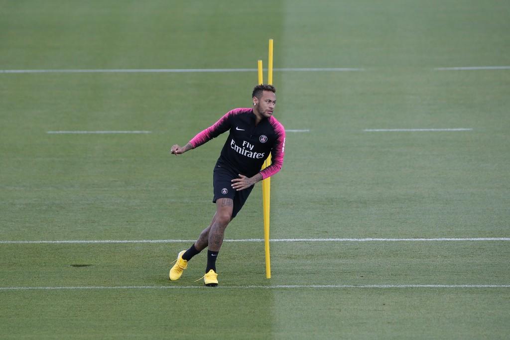 PSG's Neymar exercises during a training session at the club training center in Saint Germain en Laye, west of Paris, Friday, Aug.17, 2018. Paris Sain...