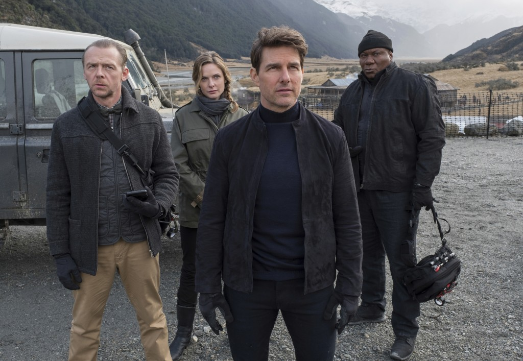 """This image released by Paramount Pictures shows, from left, Simon Pegg, Rebecca Ferguson, Tom Cruise and Ving Rhames in a scene from """"Mission: Impossi..."""