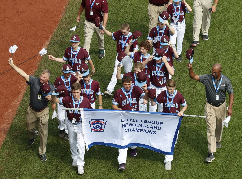 The New England Region Champion Little League team from Coventry, R.I., participates in the opening ceremony of the 2018 Little League World Series ba...
