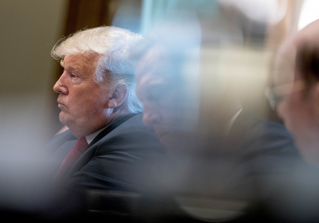 President Donald Trump listens as he attends a cabinet meeting in the Cabinet Room of the White House, Thursday, Aug. 16, 2018, in Washington. (AP Pho...