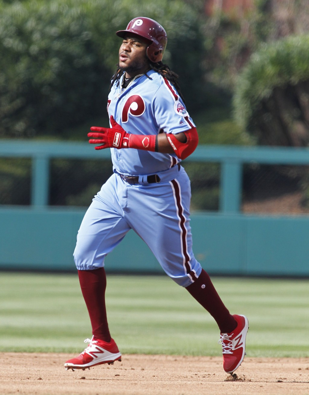Philadelphia Phillies Maikel Franco circles the bases after hitting a solo home run during the second inning of a baseball game against the New York M...