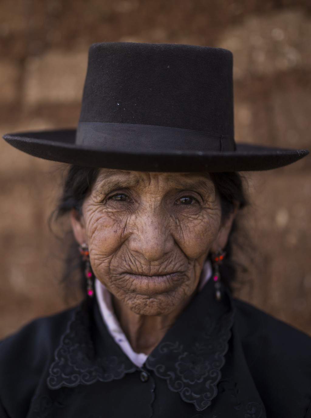 In this Aug. 15, 2018 photo, Maria Magdalena Espinosa, whose husband Daniel Tineo was killed by the Shining Path guerrillas in 1984, poses for a portr...