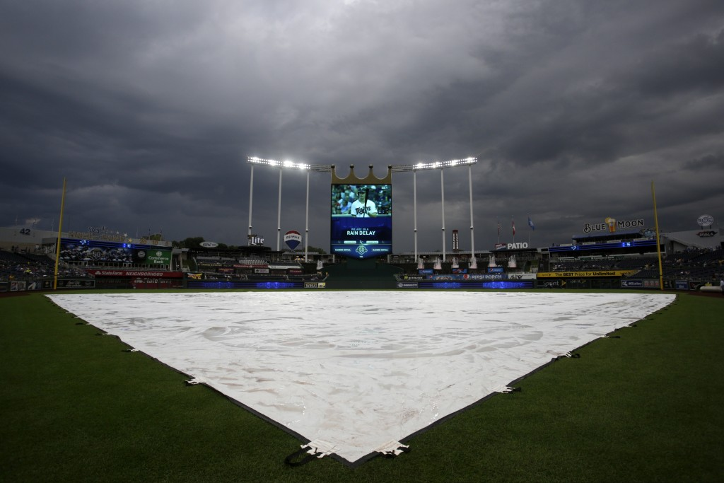 Storm clouds linger over Kauffman Stadium during a rain delay at a baseball game between the Kansas City Royals and the Toronto Blue Jays in Kansas Ci...