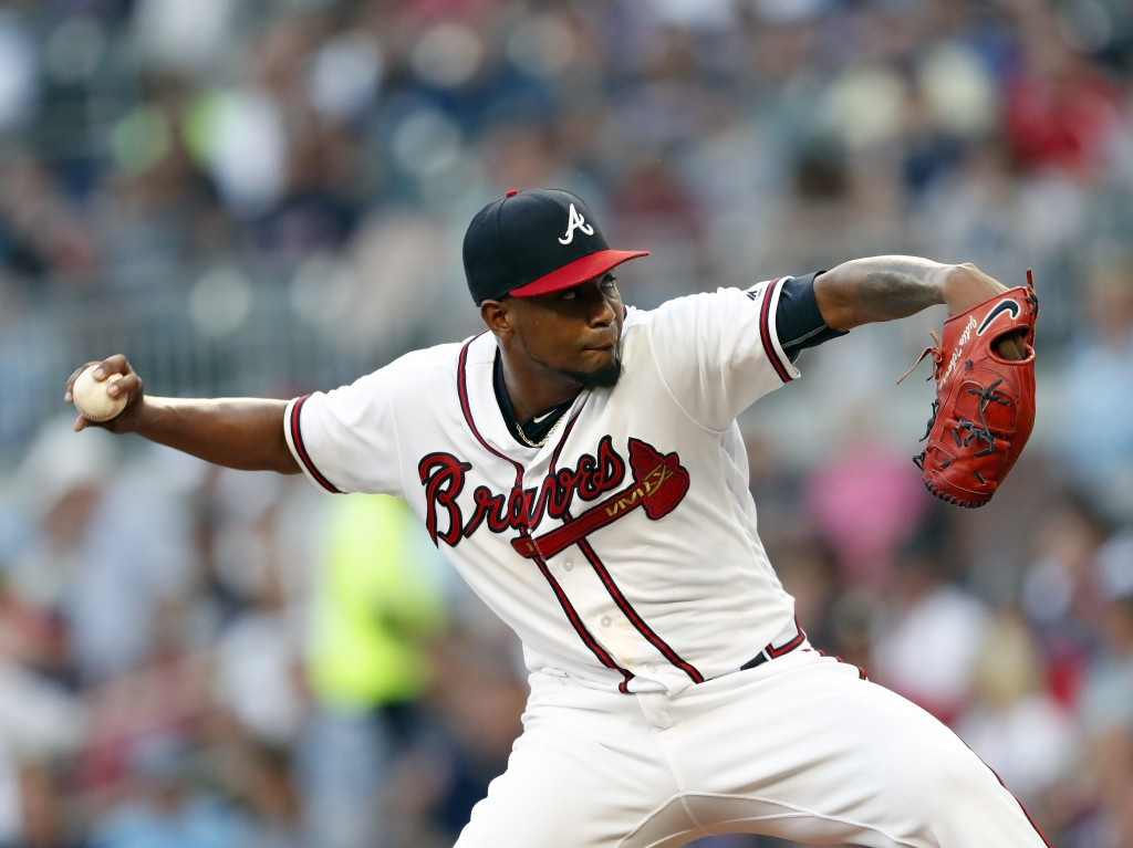 Atlanta Braves starting pitcher Julio Teheran works in the first inning of a baseball game against the Colorado Rockies on Thursday, Aug. 16, 2018, in...