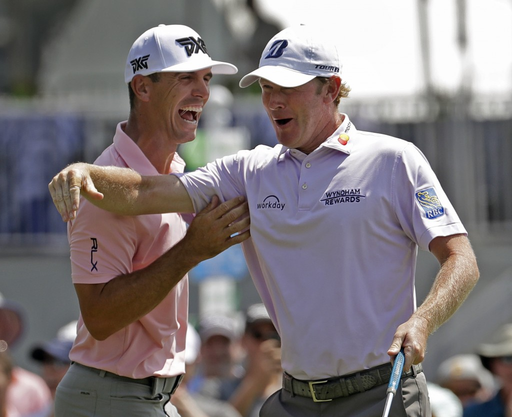 Brandt Snedeker, right, celebrates with playing partner Billy Horschel, left, after making a birdie putt on the ninth hole during the first round of t...
