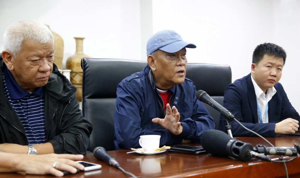 Ninoy Aquino International Airport general manager Ed Monreal, center, gestures during a news conference explaining the details after a Chinese Xiamen...