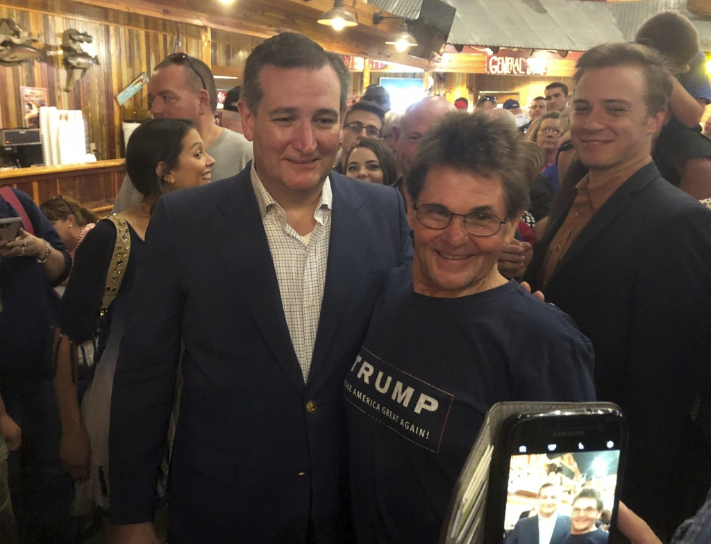 In this Aug. 10, 2018 photo, Republican U.S. Sen. Ted Cruz, left, poses with Gary Malcik following a campaign stop in Temple, Texas. Cruz says he woul...