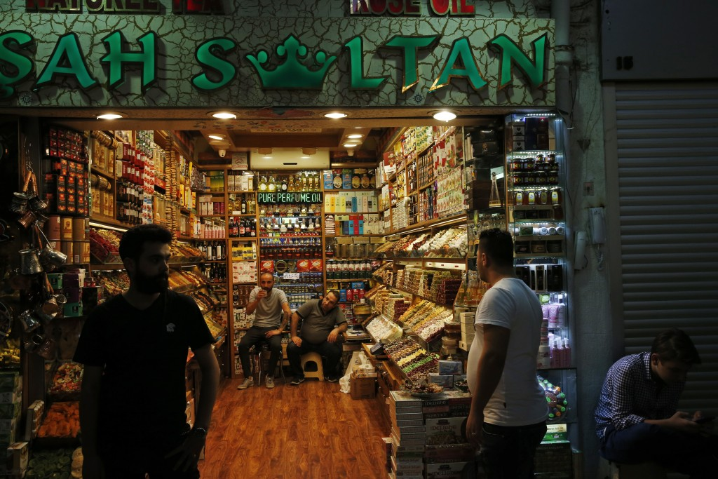 Shop owners wait for customers at Istanbul's Grand Bazaar, one of the city's main tourist attractions, Friday, Aug. 17, 2018. Turkey's lira currency f...