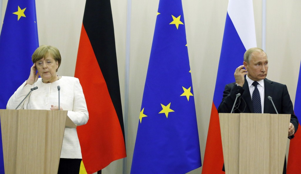FILE - In this May 18, 2018 file photo Russian President Vladimir Putin, right, and German Chancellor Angela Merkel attend news conference after their...