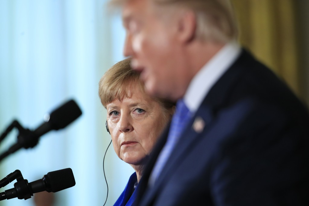 FILE - In this April 27, 2018 file photo German Chancellor Angela Merkel listens to President Donald Trump talk, during a news conference in the East ...