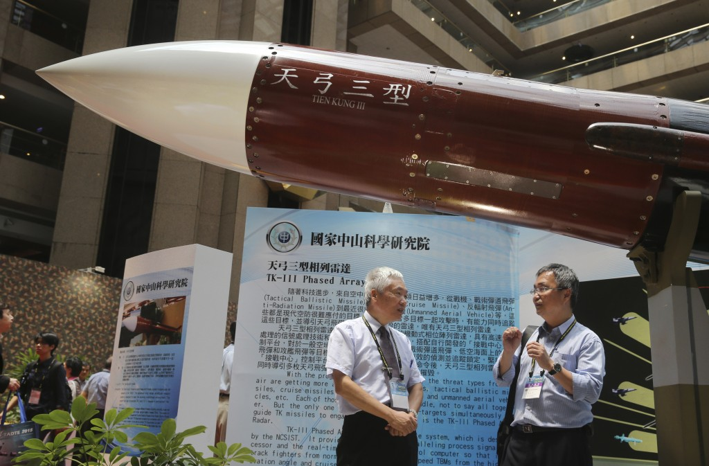 """FILE - In this Aug. 13, 2015, file photo, two men speak under the Taiwan-made """"Tien-Kung III"""" surface to air missile during the 2015 Taipei Aerospace ..."""