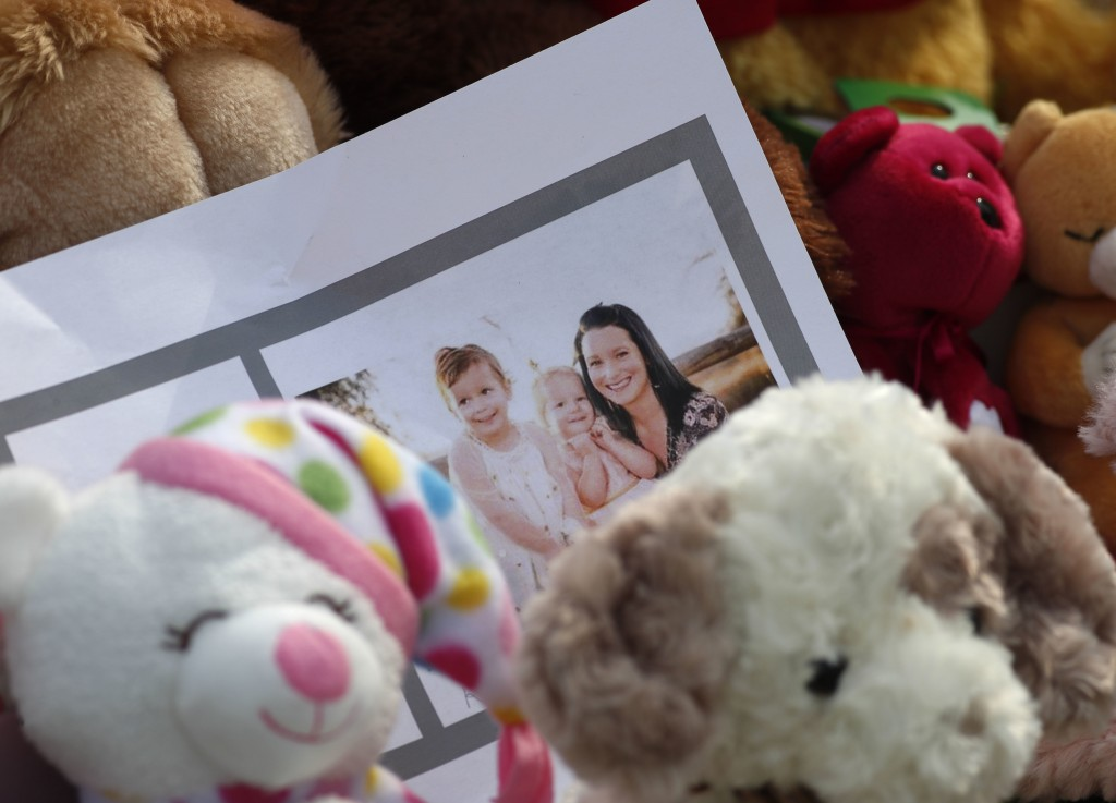 A photograph sits amid the tributes as they grow outside the home where a pregnant woman, Shanann Watts, and her two daughters, Bella and Celeste, liv...
