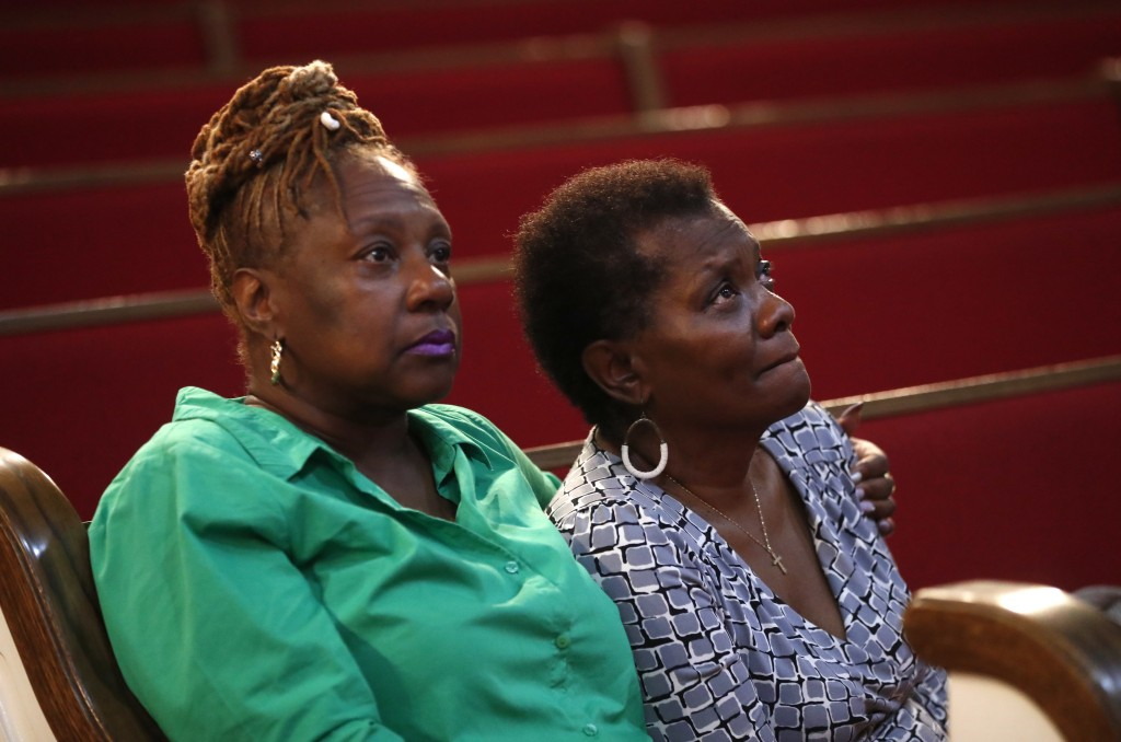 """Leslie Mathews, left, and Emma Lockridge sit in New Bethel Baptist Church in Detroit, Thursday, Aug. 16, 2018. Aretha Franklin, the undisputed """"Queen ..."""