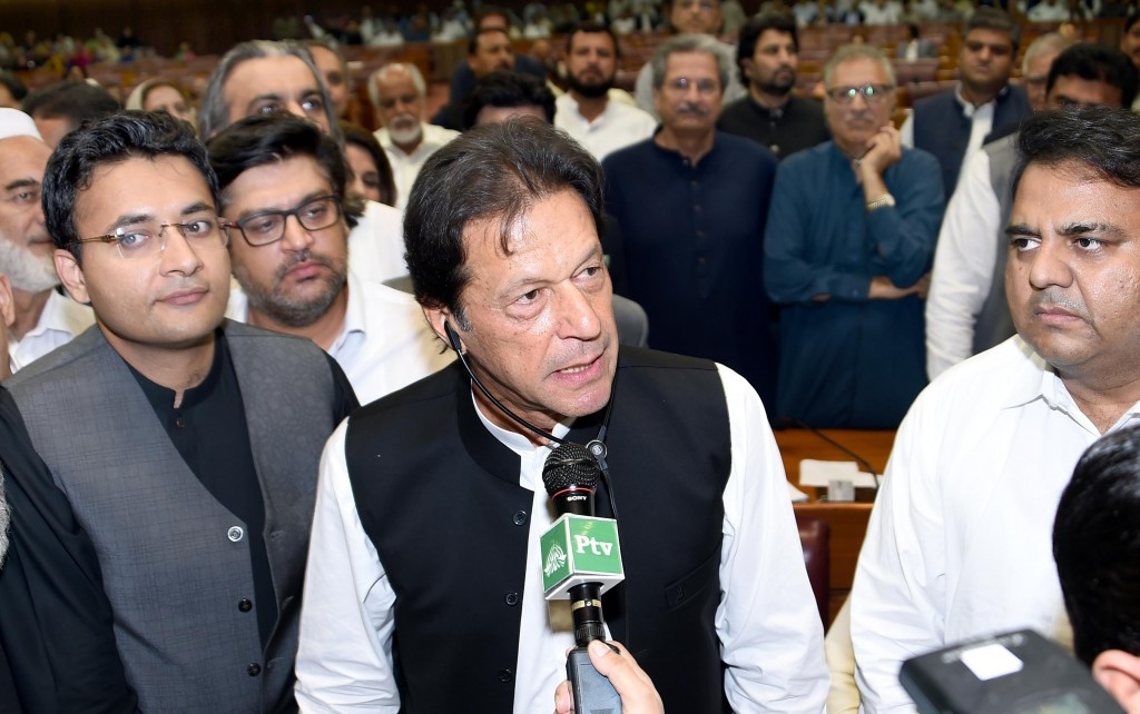 In this photo released by the National Assembly, the leader of Pakistan Tahreek-e-Insaf party Imran Khan,speaks at the National Assembly in Islamabad,...